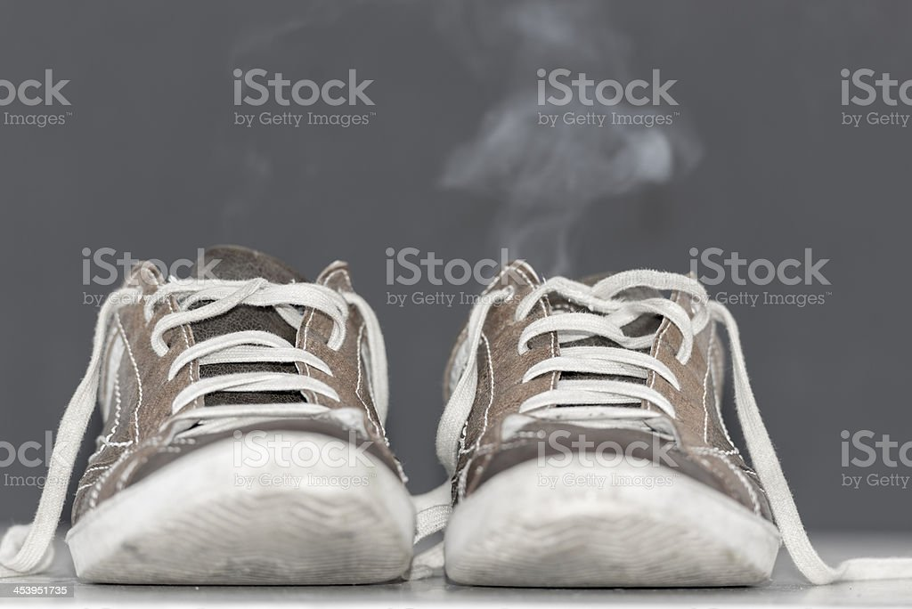 Shoes with smoke royalty-free stock photo