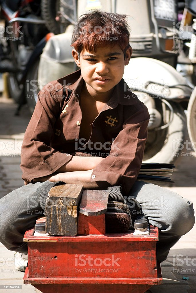 shoeshiner kid , indian Cobbler royalty-free stock photo