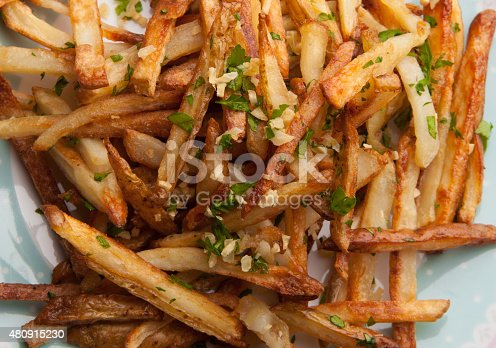 Shoestring fries with garlic and herbs