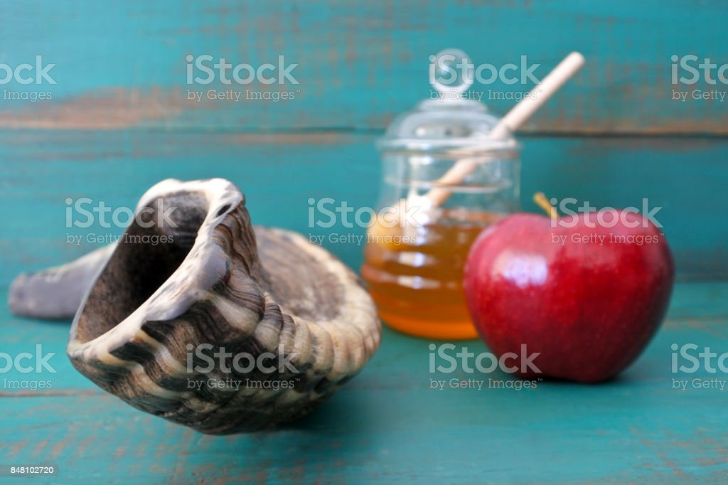 Shofar Honey and apple on a turquoise background stock photo