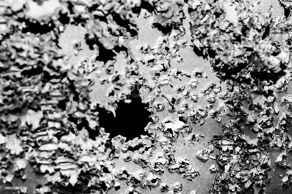 Shooitng target full of bullet holes. Black and White. stock photo