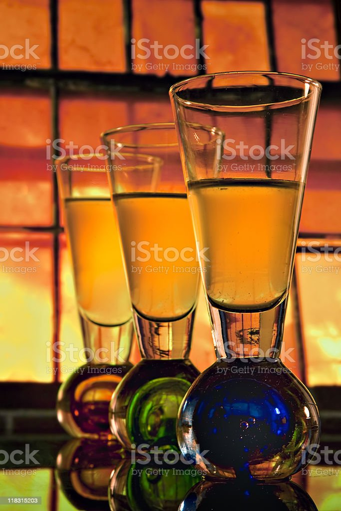 Shooter glasses in front of orange window