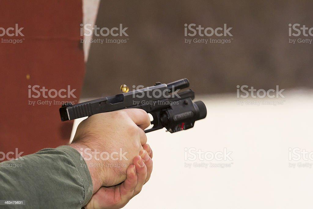 marksman with his gun at firing range