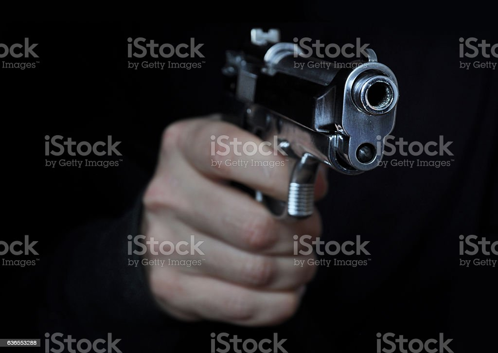 Shooting a gun stock photo