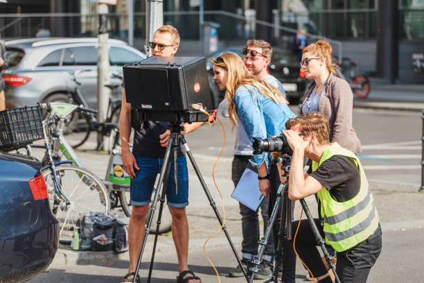 shooting a movie or film at city street of berlin - serie televisiva foto e immagini stock