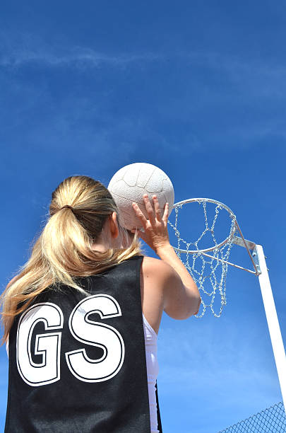 Shooting a Netball stock photo