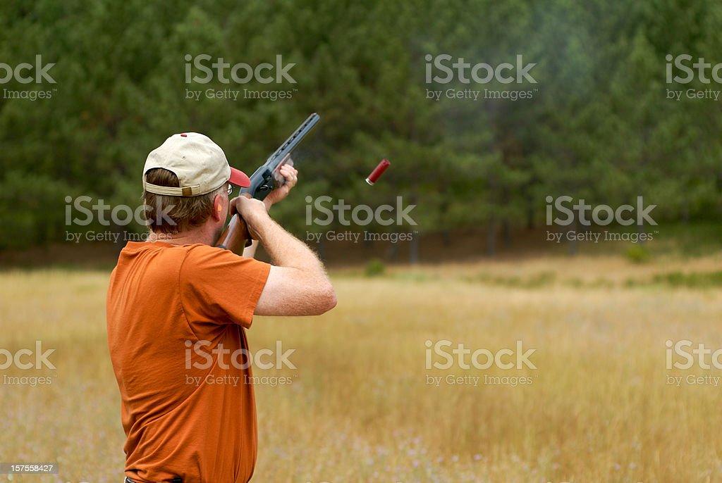 Shooting a shotgun shell casing in air stock photo