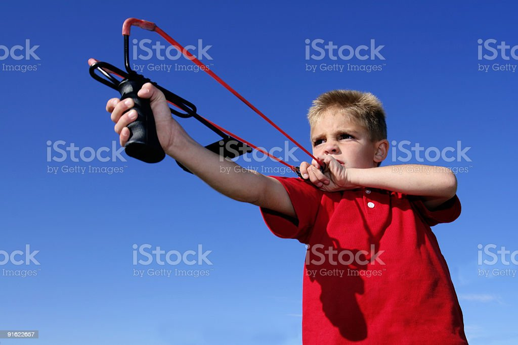 Shooting a slingshot stock photo