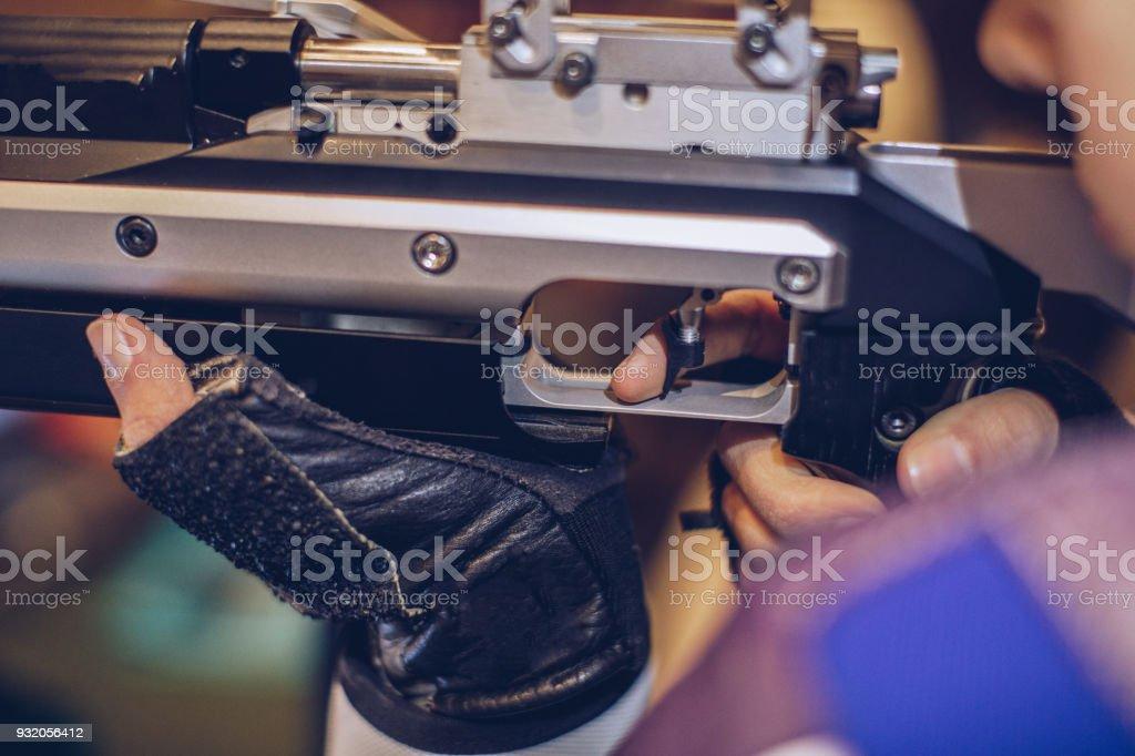 Shooting range. A woman with a machine gun