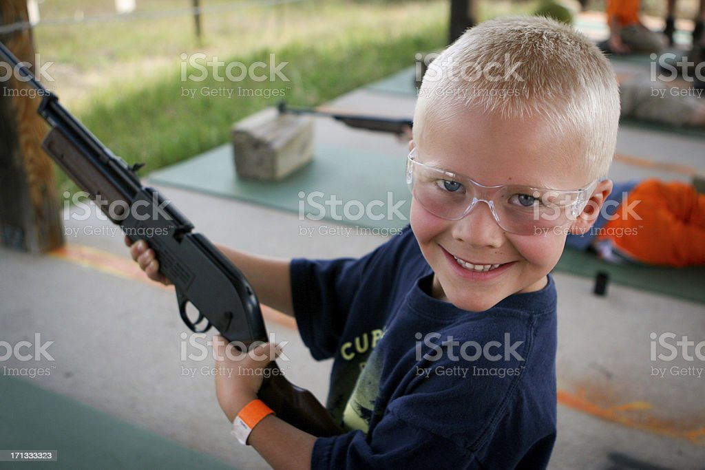 Shooting bb gun at camp stock photo