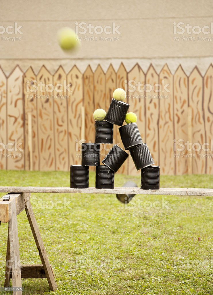 Shooting cans with balls stock photo