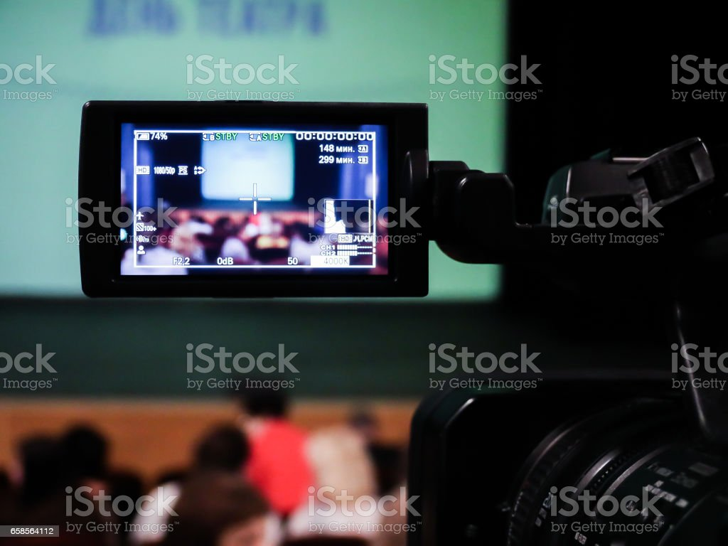 Shooting concert video. Control monitor. Blurred background, bokeh. Videography royalty-free stock photo