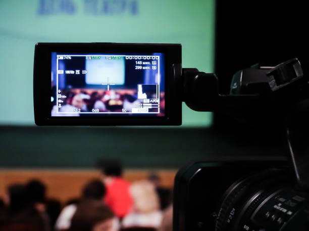 Shooting concert video. Control monitor. Blurred background, bokeh. Videography stock photo