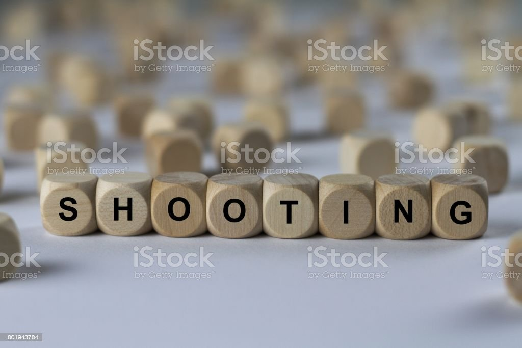 shooting - cube with letters, sign with wooden cubes stock photo