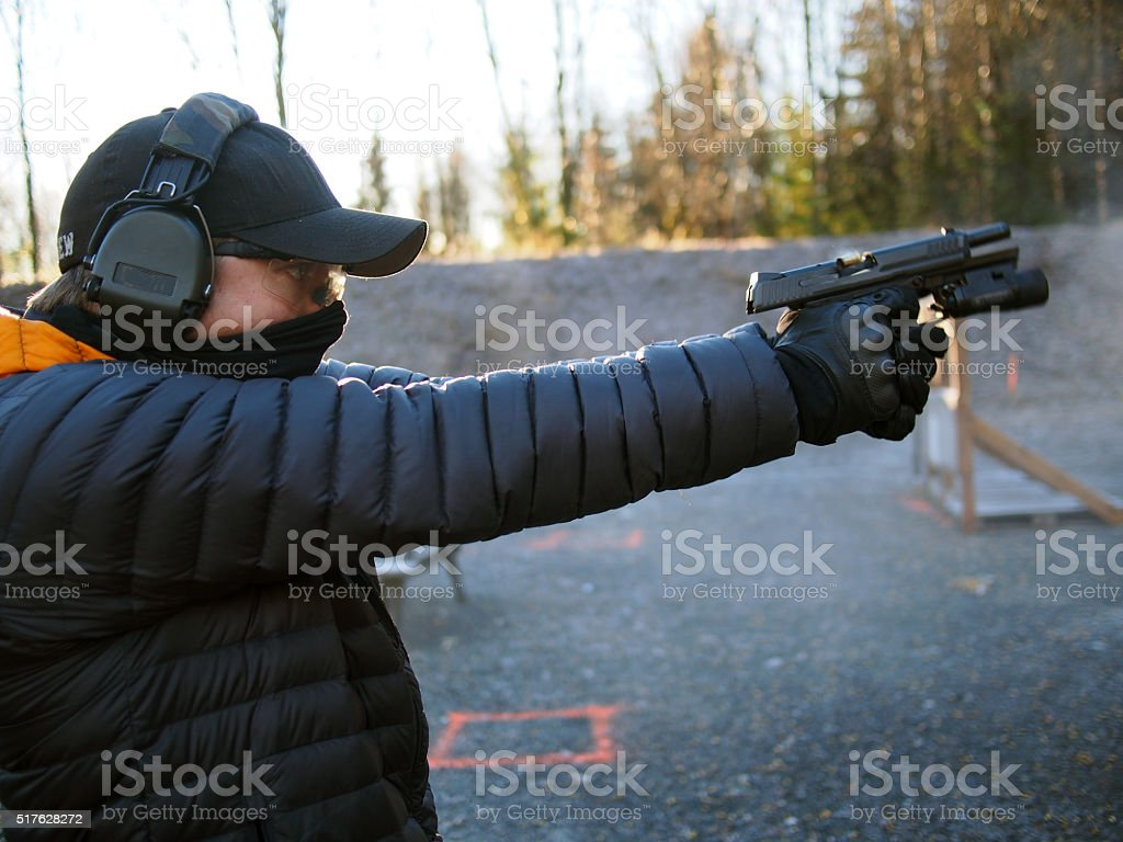 Shooting handgun stock photo