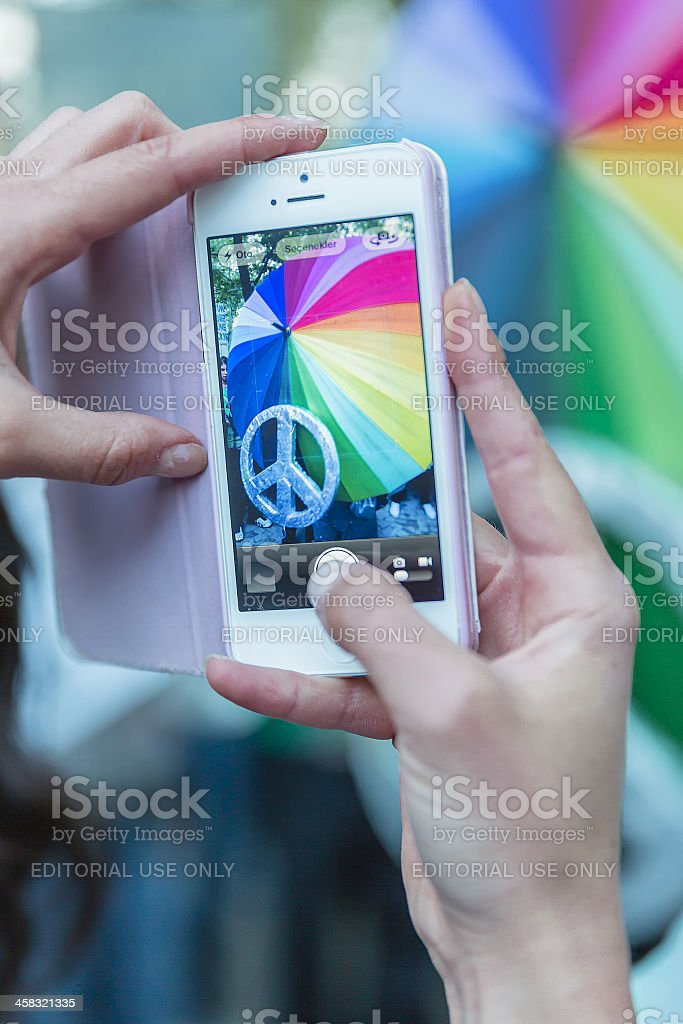 Shooting Peace all brotherhood's umbrella with mobil phone stock photo