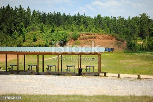 Shooting range in woods with pavilion and shooting tables and targets
