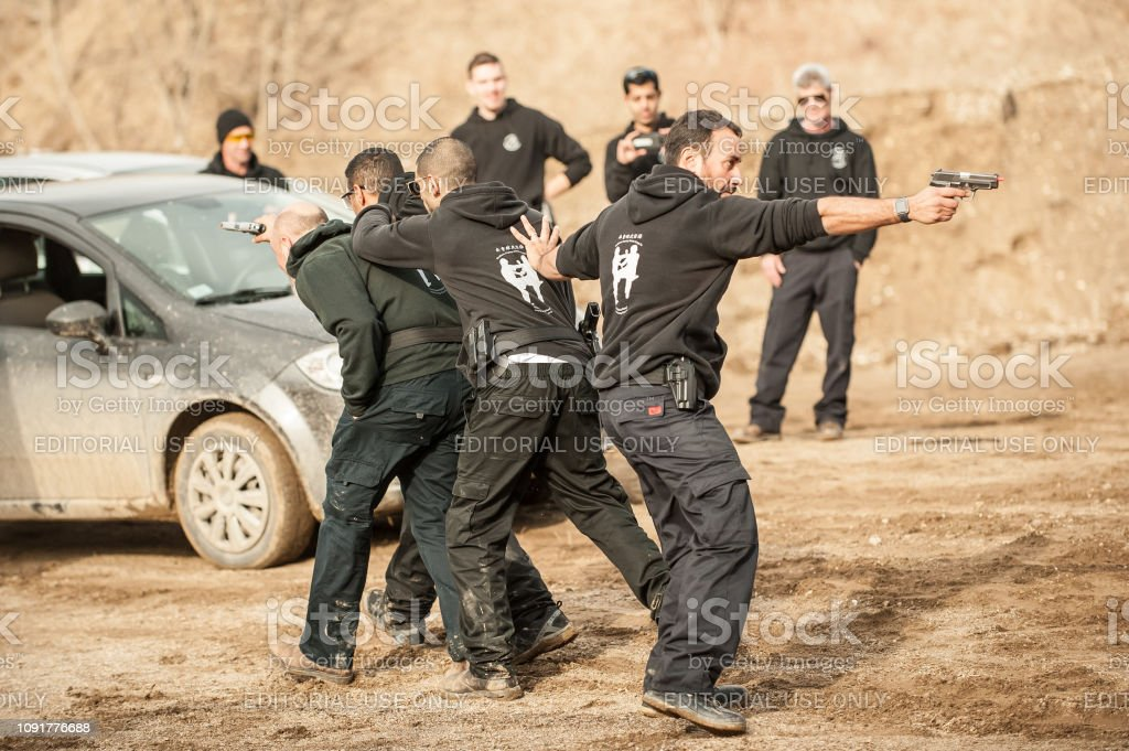 Shooting range. Large group of students practice action gun shooting stock photo
