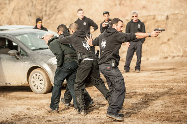 Shooting range. Large group of students practice action gun shooting Pozarevac, Serbia - December 21-24, 2018: Large group of kapap students practice action gun shooting on target in the shooting range GROM on KAPAP BASIC FIREARMS SAFETY AND GUN USE SEMINAR police meeting stock pictures, royalty-free photos & images