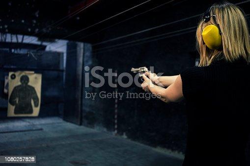 Woman at shooting range