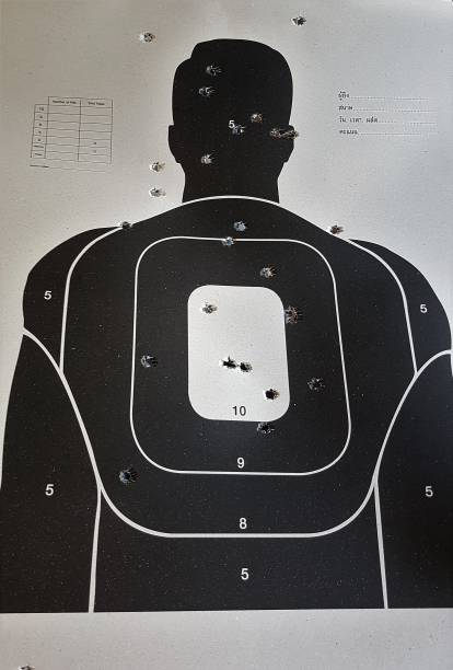 shooting range used target with bullet holes in human body. - target australia stock pictures, royalty-free photos & images
