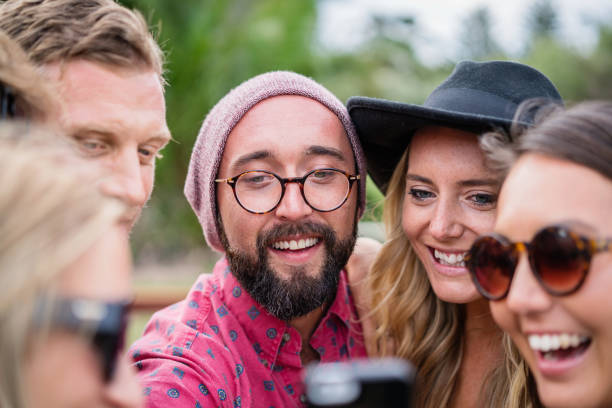 Shooting Selfies Friends Together Having Fun stock photo