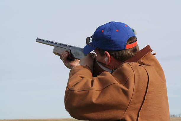 Shooting Skeet Man shooting skeet bird hunting stock pictures, royalty-free photos & images