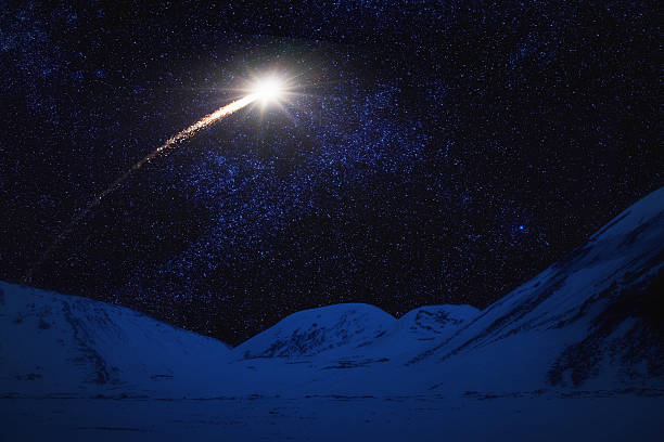 shooting star over winter landscape - shooting stars stock photos and pictures