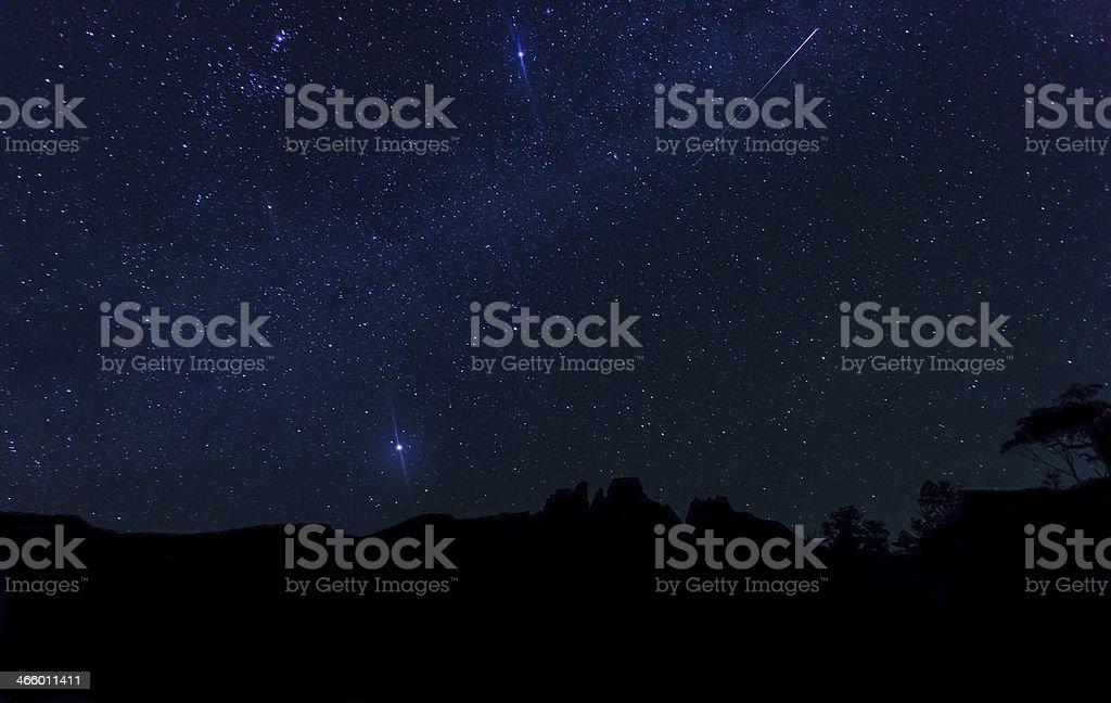 Night sky over mountain range in Tasmania, Austalia.