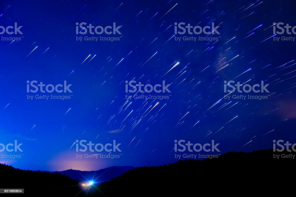 Scene of shooting starry sky at night on high mountains in...