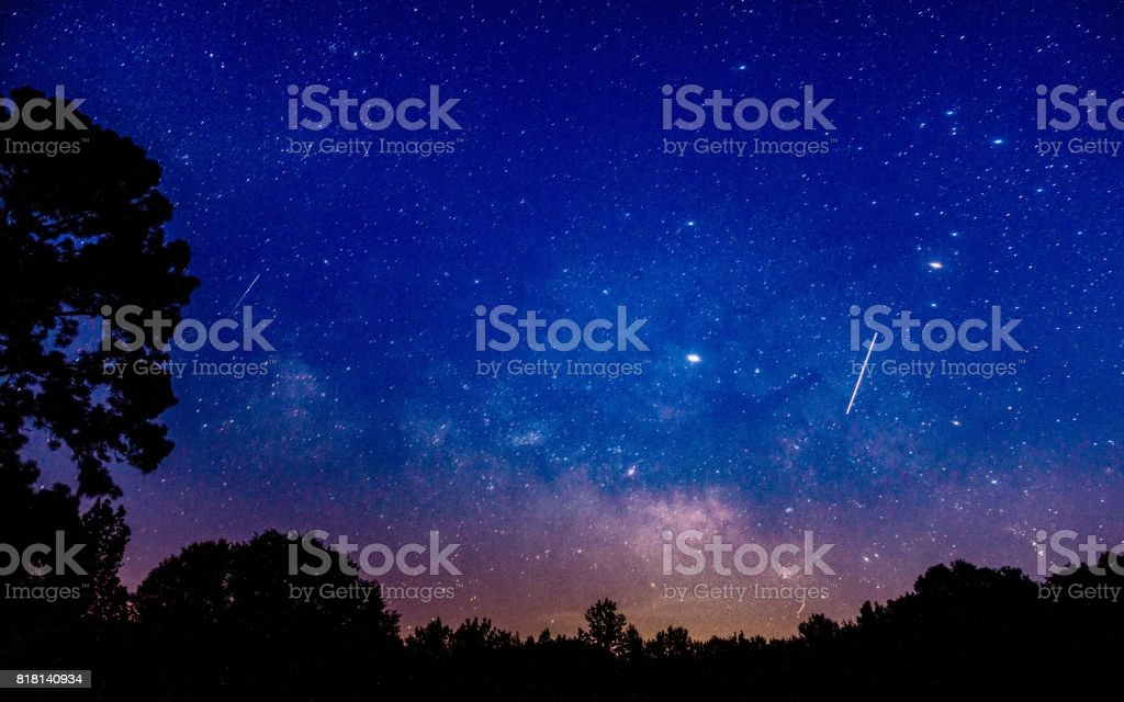 Two shooting stars visible along with the rising Milky Way in an...