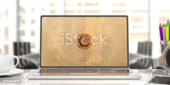 1043434558 istock photo Shooting target on a computer screen, blur office background. 3d illustration 1043434550