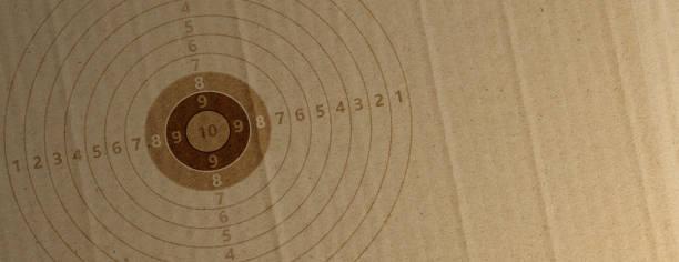 shooting target on recycling carton paper, banner, copy space. 3d illustration - tarcza broń zdjęcia i obrazy z banku zdjęć