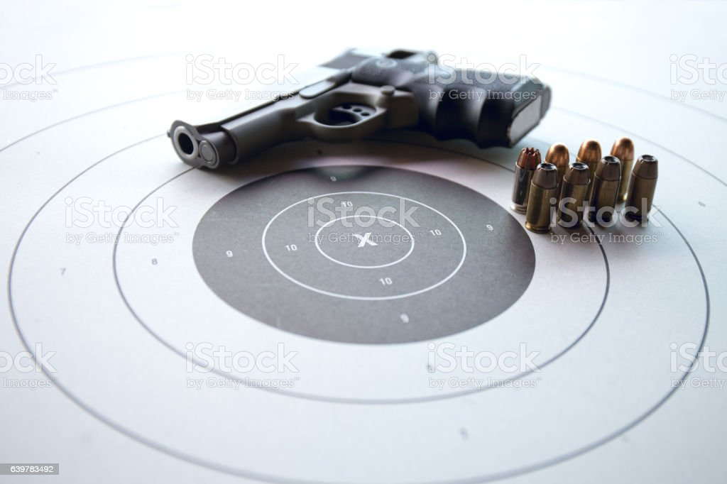 shooting target with gun and bullet stock photo
