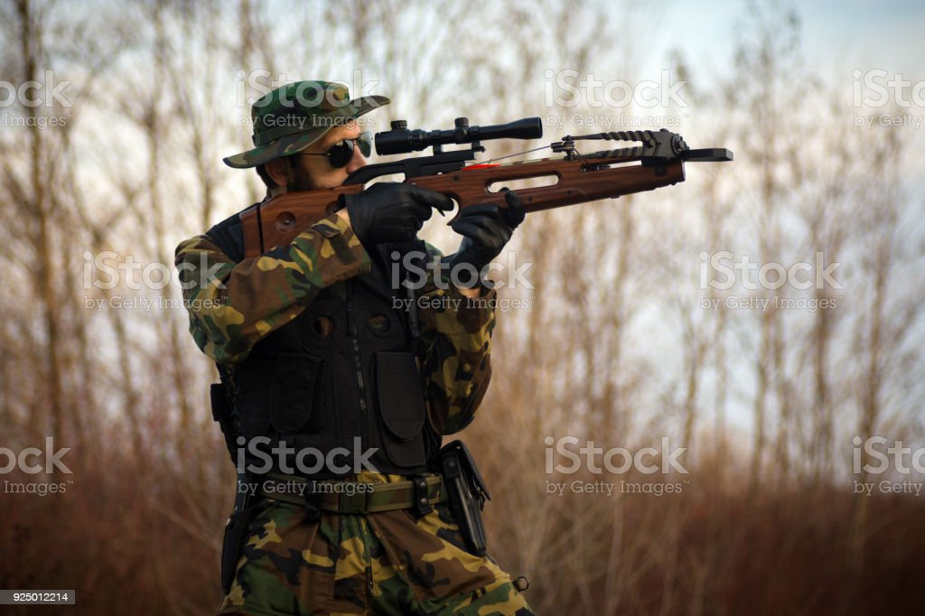 shooting with crossbow stock photo