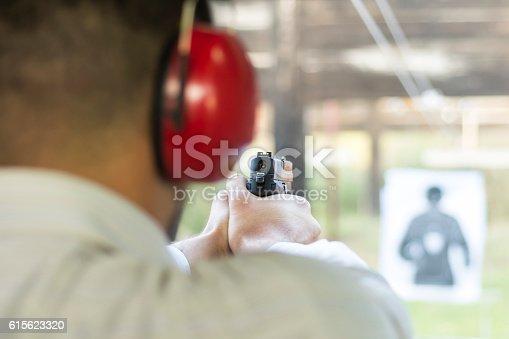 istock Shooting with Gun at Target in Shooting Range 615623320