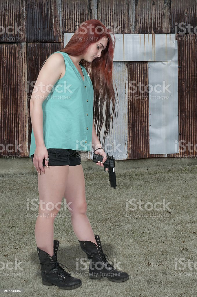 Shooting Yourself in the Foot stock photo