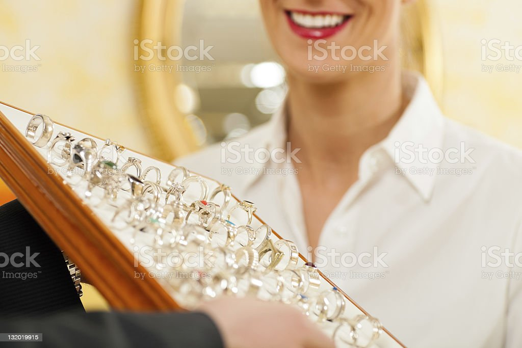 Shop assistant at the jeweller stock photo
