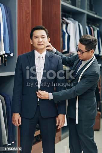 istock Shop assistant helping customer 1126306320