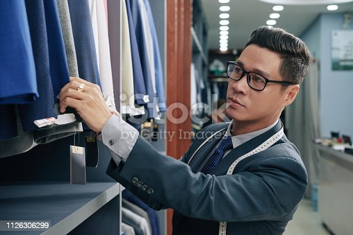 istock Shop assistant working in store 1126306299