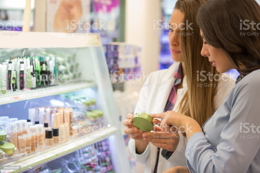 Shop assitant advising customer stock photo