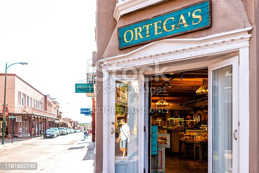 Santa Fe, USA - June 14, 2019: Shop called Ortega's on old town street in United States New Mexico city with adobe style architecture