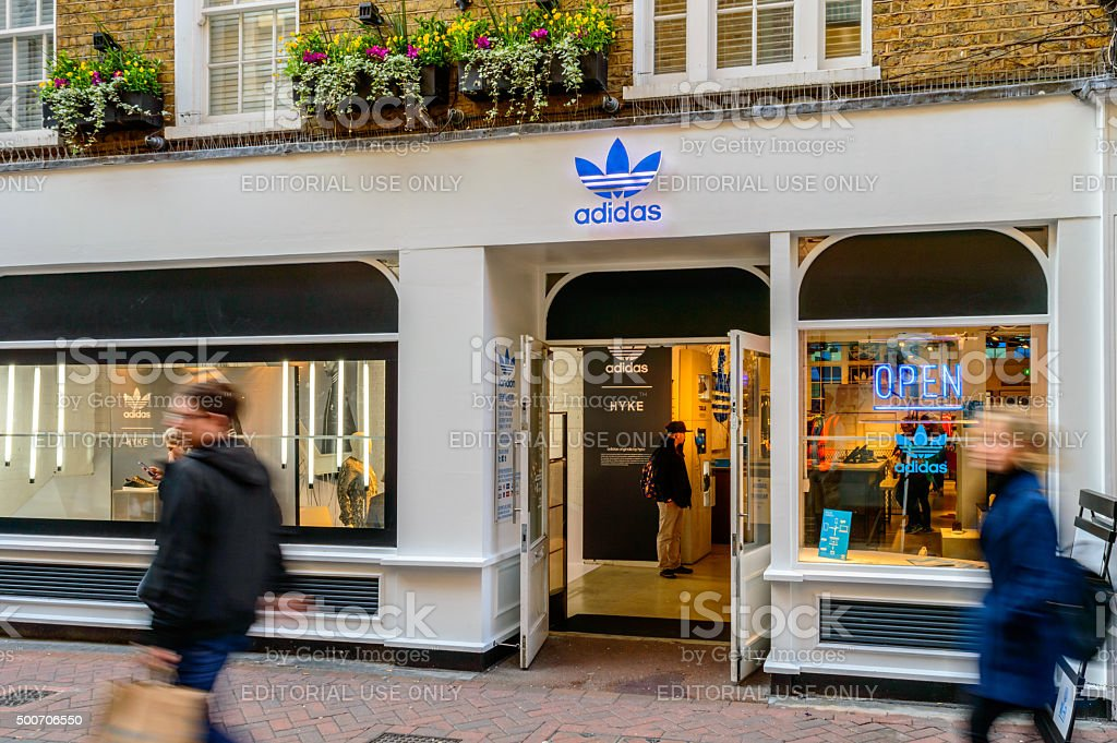 Shop front of Adidas Originals store, people passing by, London stock photo