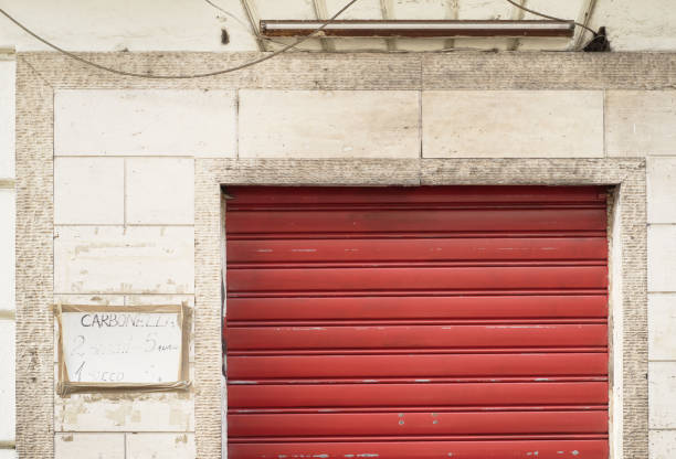shop front, shut, red rolling garage door stock photo