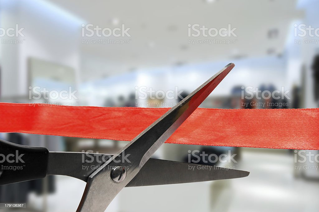 shop grand opening - cutting red ribbon stock photo