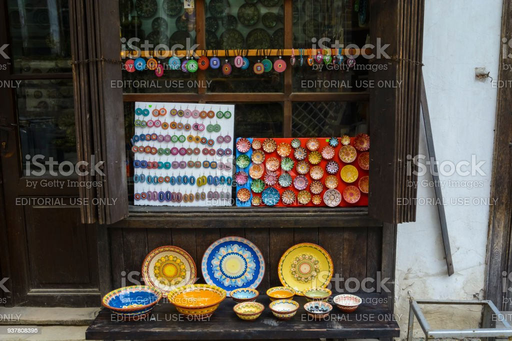 Shop in the pedestrian street in the Old town, traditional colorful Plates are handmade by local artisans stock photo