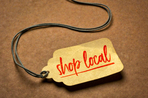 shop local sign  on a price tag stock photo