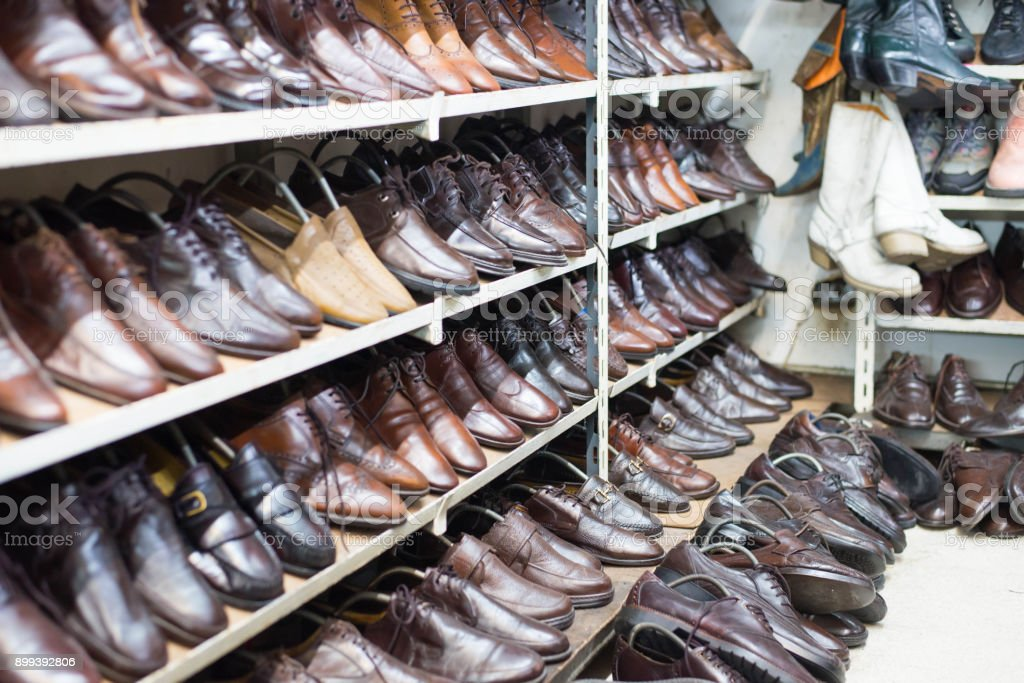 Shop of second hand leather shoes. Many used shoes for sale.