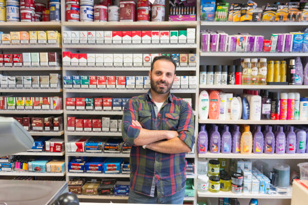Shop owner from minority group Color image of an ethnic shop owner in Amsterdam, standing in front of various products. Copy space left and right. armenian culture stock pictures, royalty-free photos & images