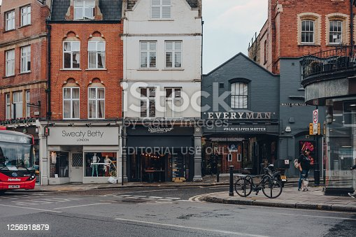 London, UK - July 02, 2020: Shop, restaurant and Everyman cinema on a street in Hampstead, selective focus. Hampstead is an affluent residential area of London favoured by artists and media figures.